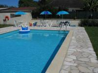 Châlet Basse Normandie Cozy chalet at Osmanville Normandy with Swimming Pool