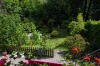 gite Saint Crespin L'escale Arquaise, la maison au jardin fleuri